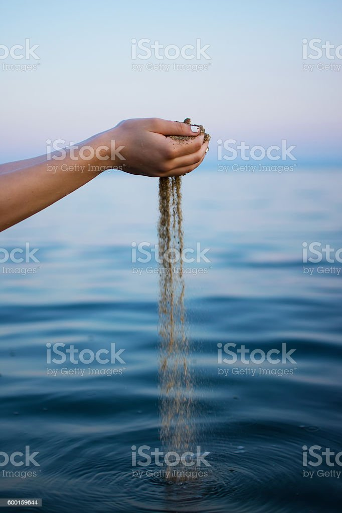 Woman Hands Holding Sand Close up, Beach Outdoors Background. stock photo