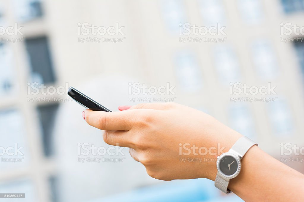 Woman hands holding smartphone stock photo