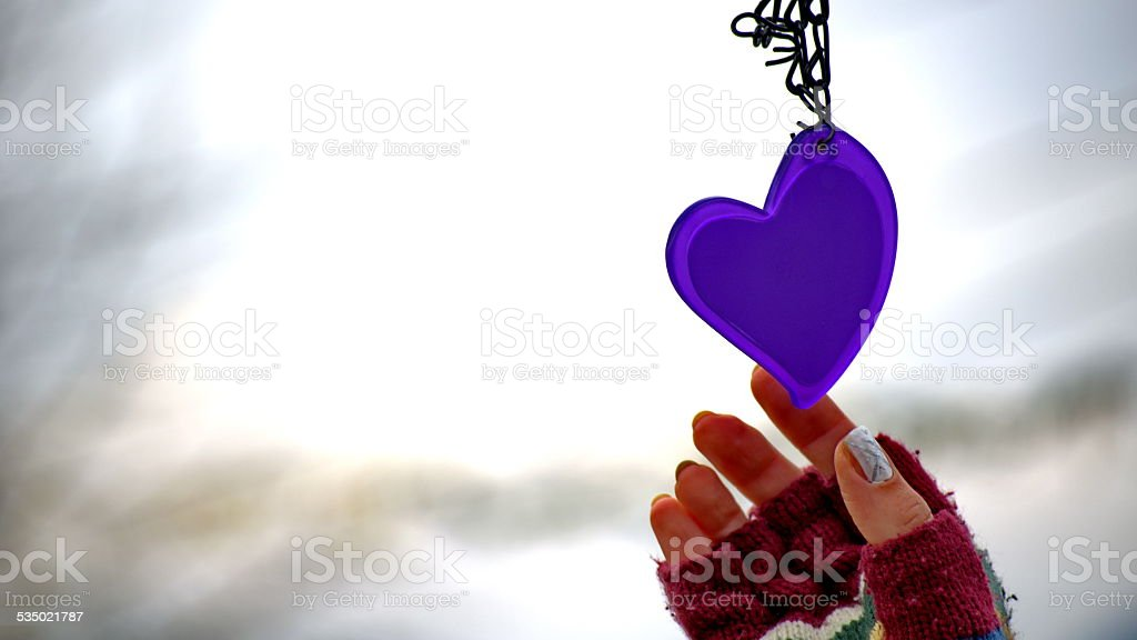 Woman hands in mittens reaching for a heart royalty-free stock photo