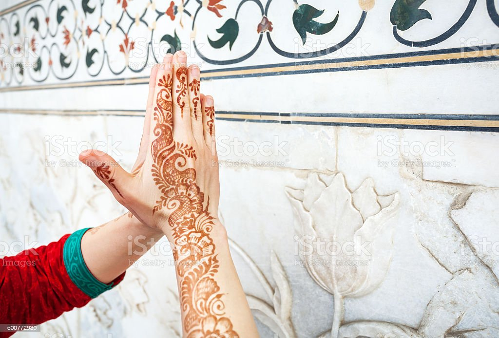 Woman hands in namaste in India stock photo