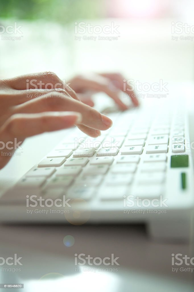woman Hands is  typing stock photo