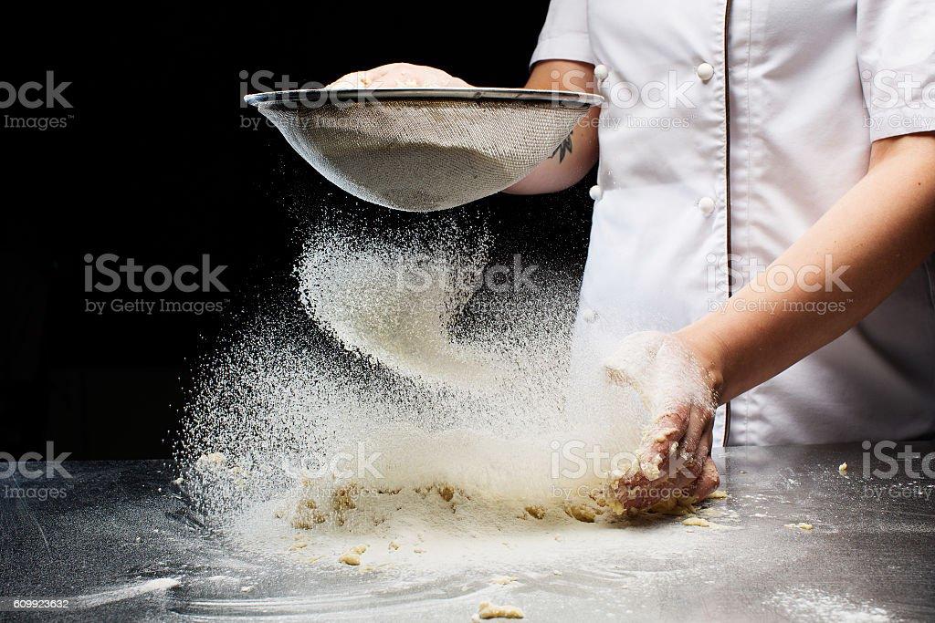 Woman hands kneading dough. stock photo