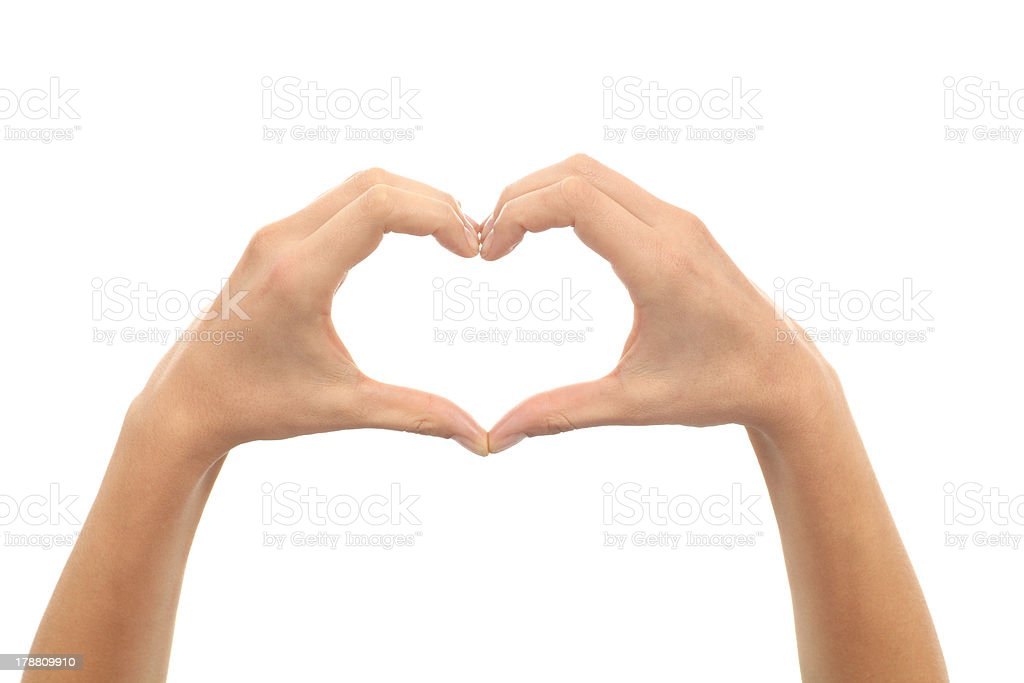 Woman hands making a heart shape stock photo