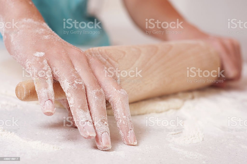 Woman hands mixing dough on the table royalty-free stock photo