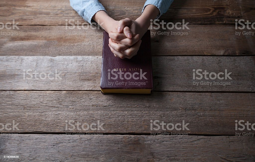 woman hands on bible stock photo