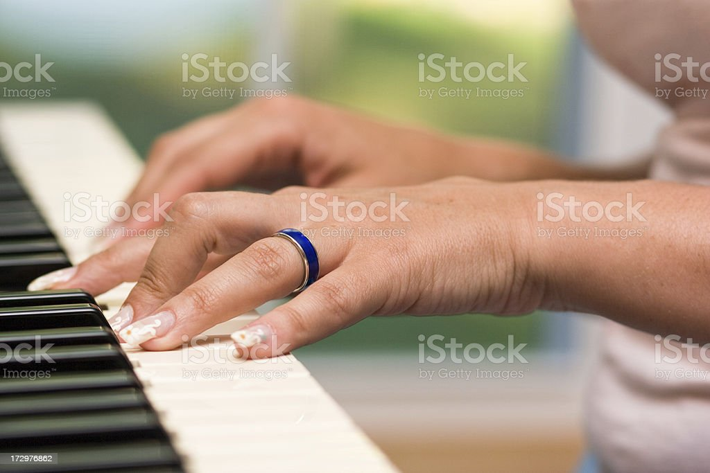 woman hands on the piano keyboard stock photo