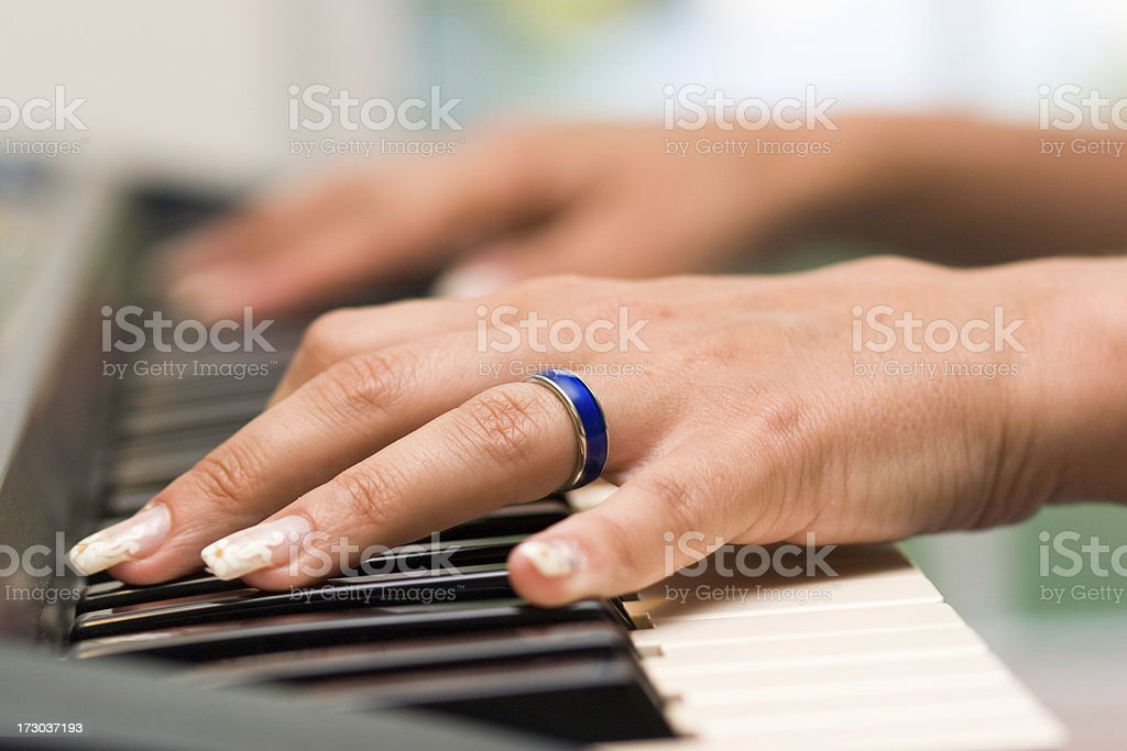 woman hands on the piano keyboard royalty-free stock photo