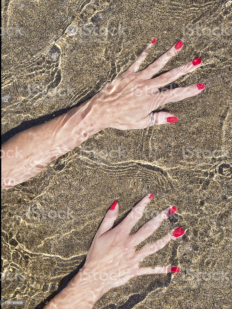 woman hands on  water foreshore,  black sand royalty-free stock photo