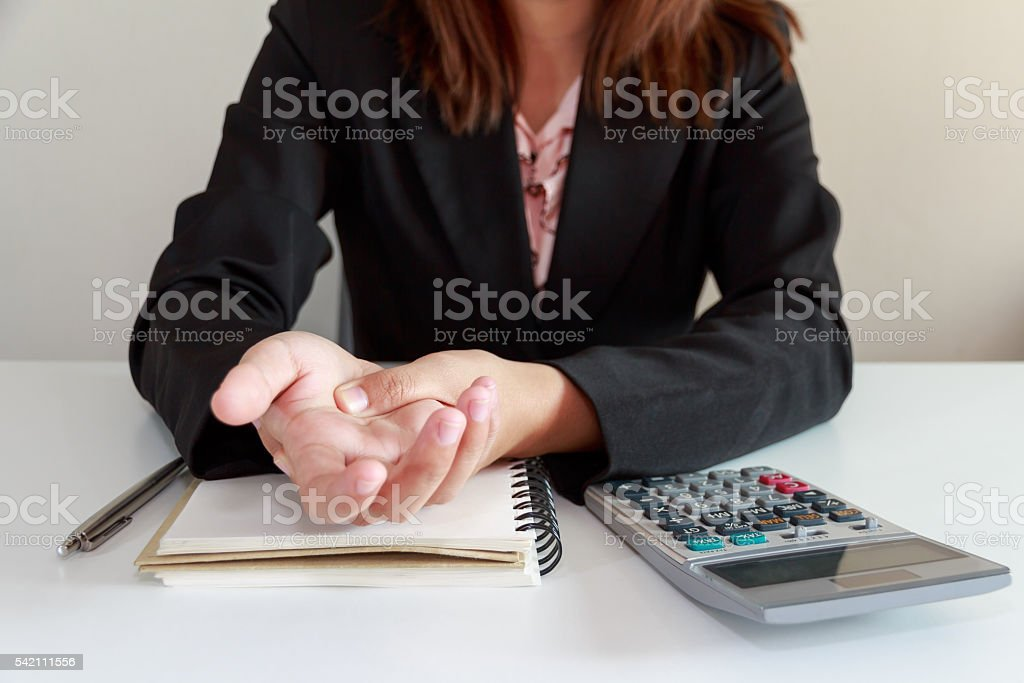 Woman hands pain on desk office syndrome concept stock photo