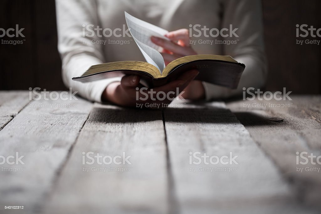 Woman hands praying with a bible stock photo