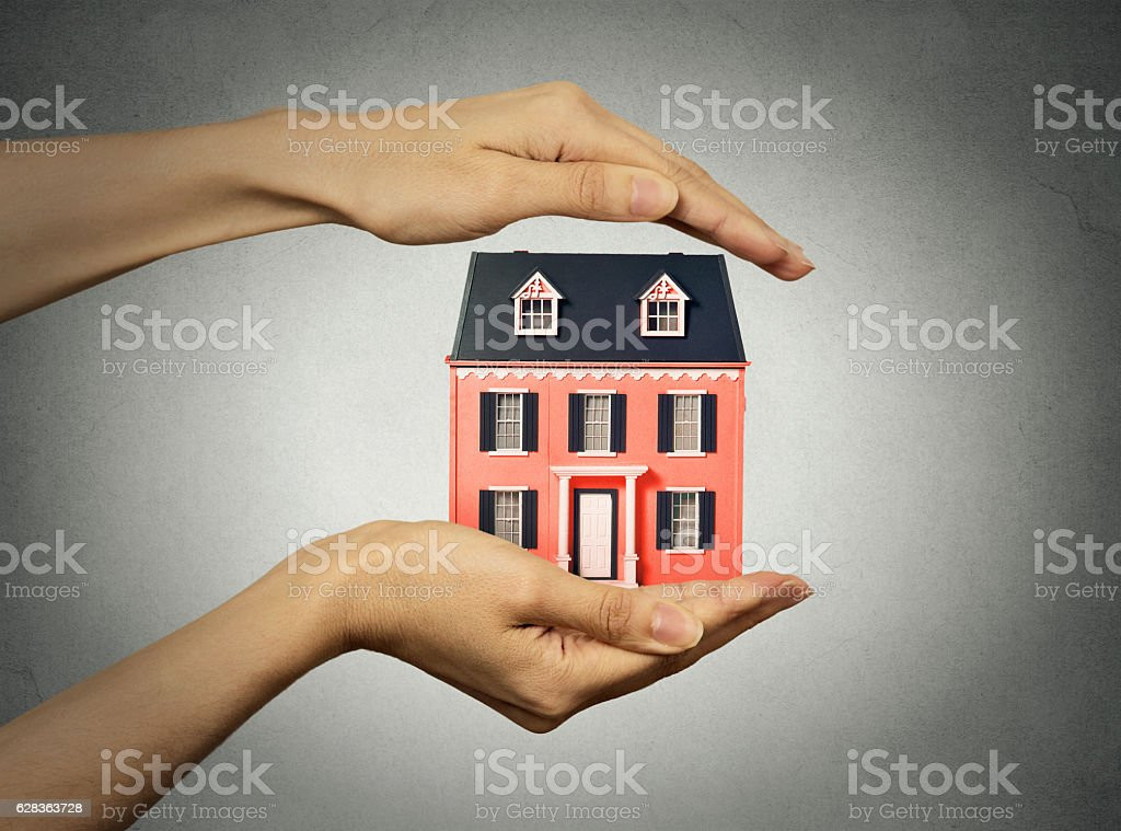 woman hands presenting small model of house stock photo