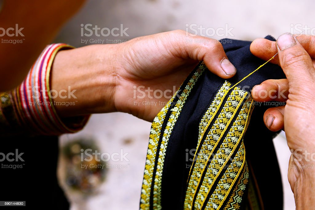 Woman hands sewing in North Vietnam stock photo