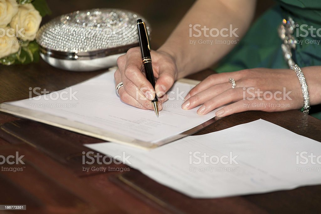 woman hands sign up marriage certificate royalty-free stock photo