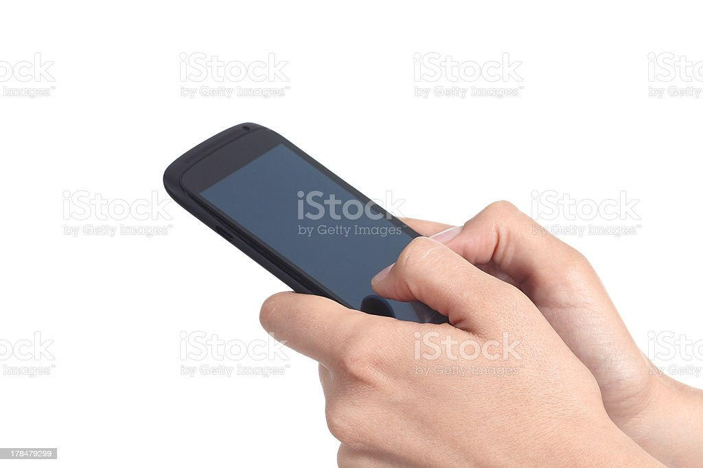 Woman hands touching a mobile phone screen with her thumbs stock photo