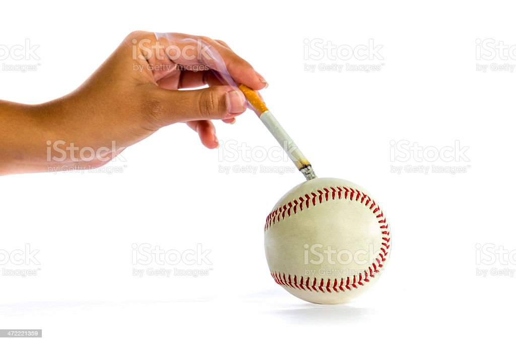 Woman hands turning off ciggarette on ball for quitting smoking royalty-free stock photo
