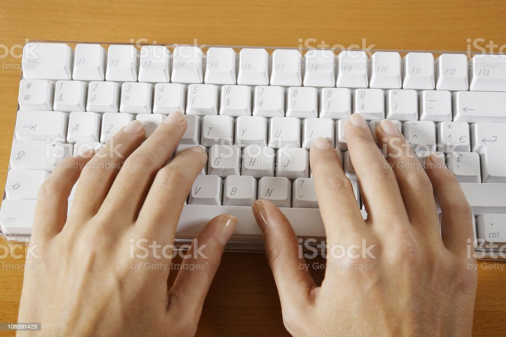 woman hands typing on a keyboard computer stock photo