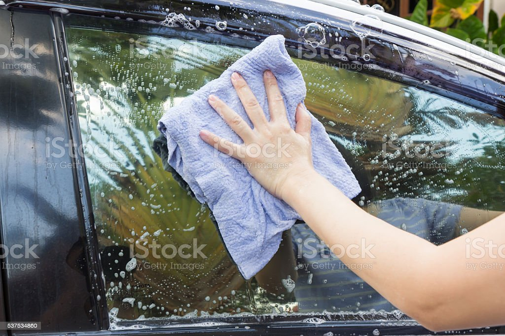 Woman hands washing a white car stock photo