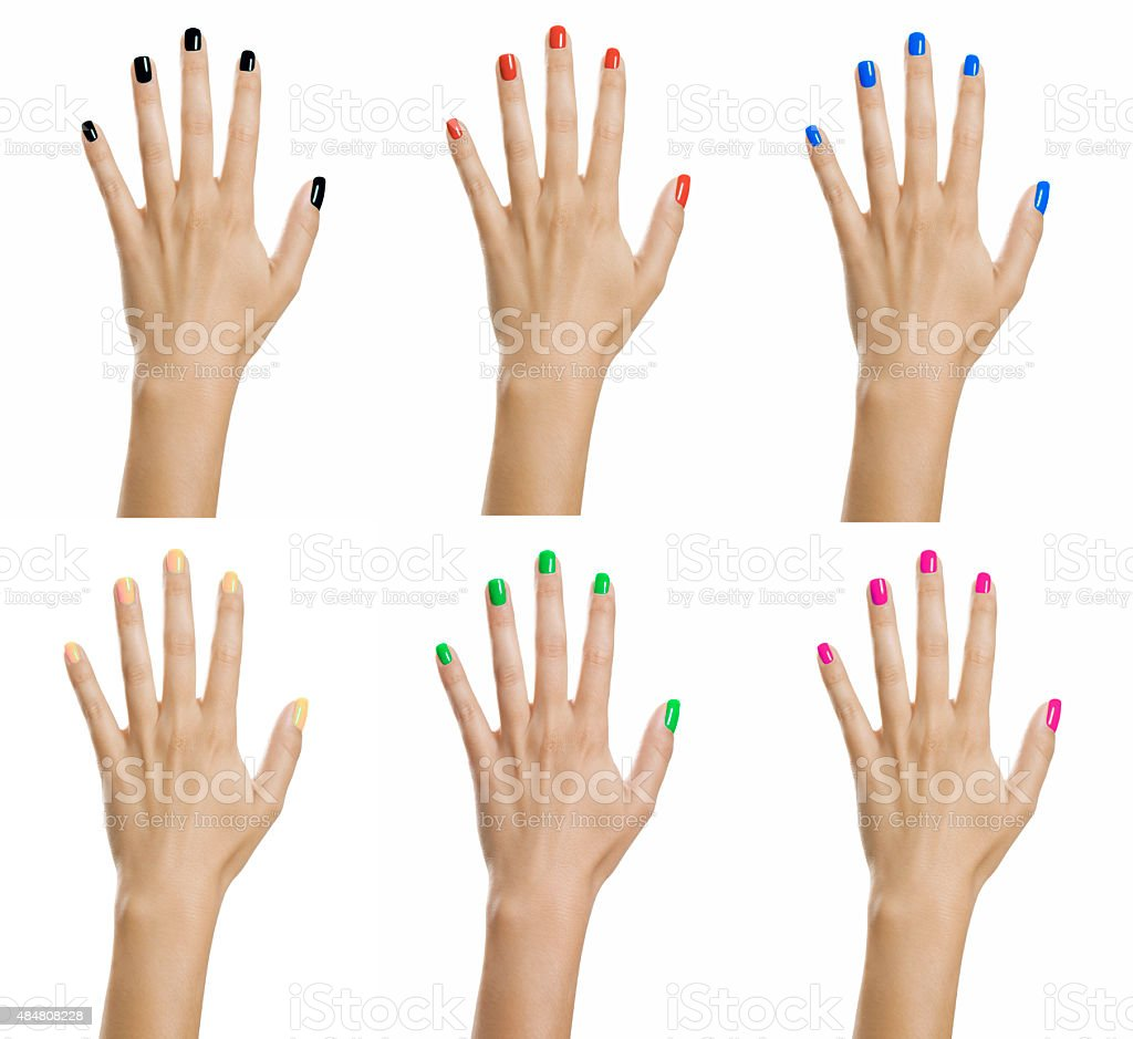 Woman hands with colorful nail varnish stock photo