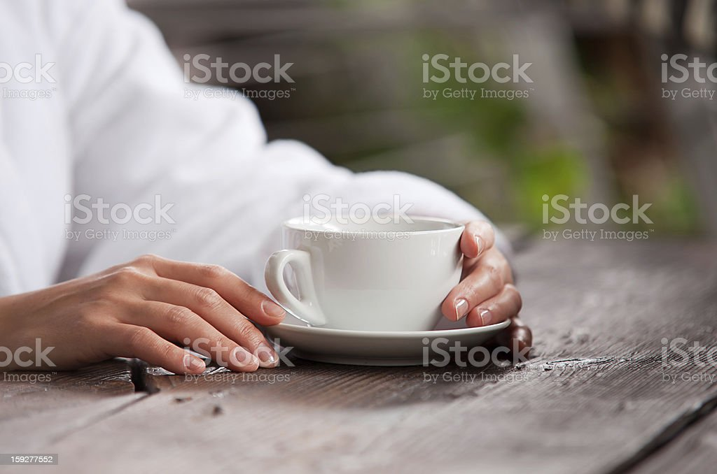 Woman hands with cup of morning tea royalty-free stock photo