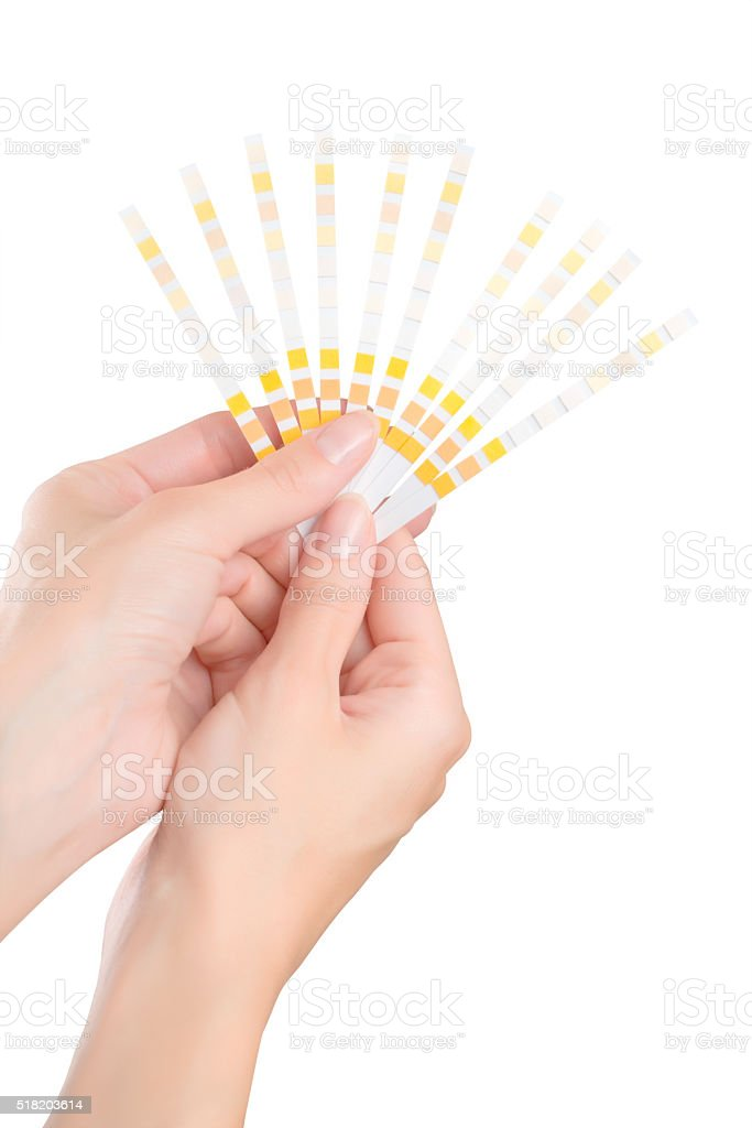 Woman hands with fan of test strips stock photo