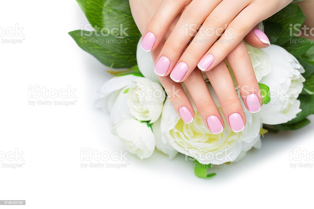 Woman hands with french manicure stock photo