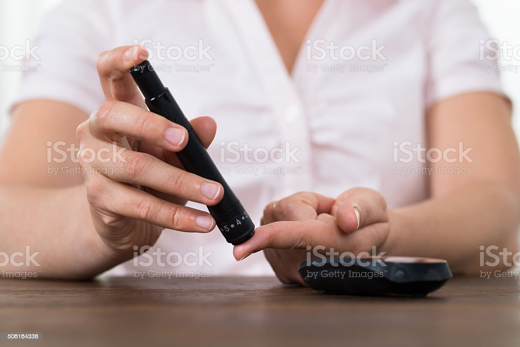 Woman Hands With Glucometer stock photo