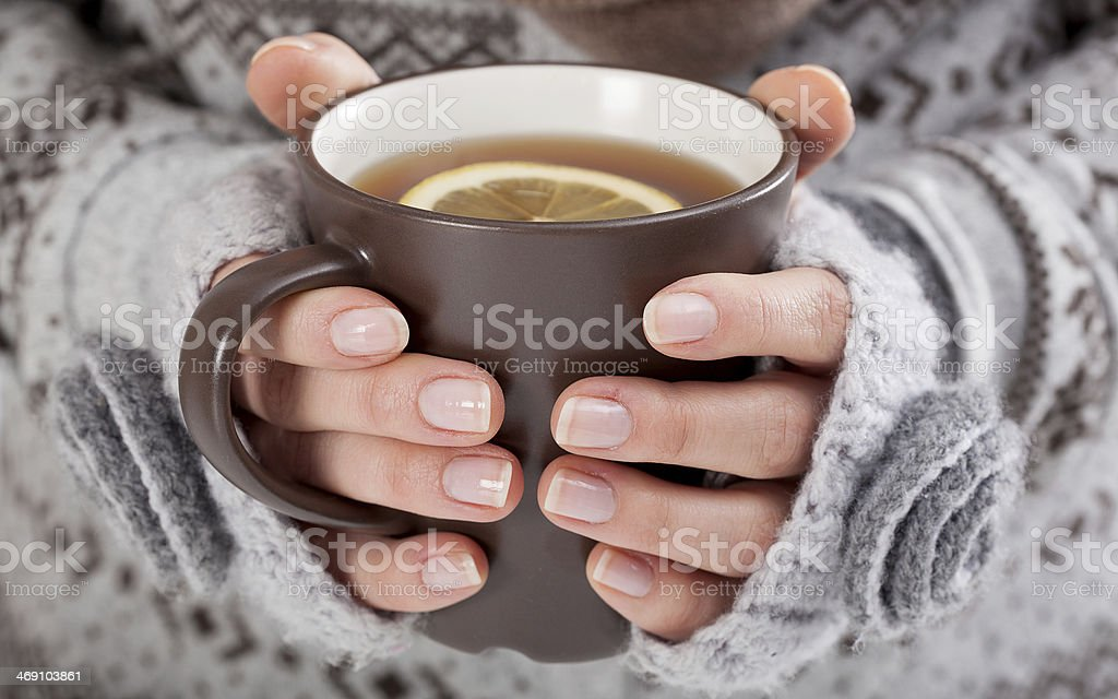 Woman hands with hot drink stock photo