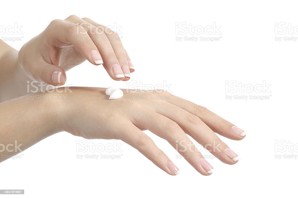 Woman hands with perfect manicure applying moisturizer cream stock photo