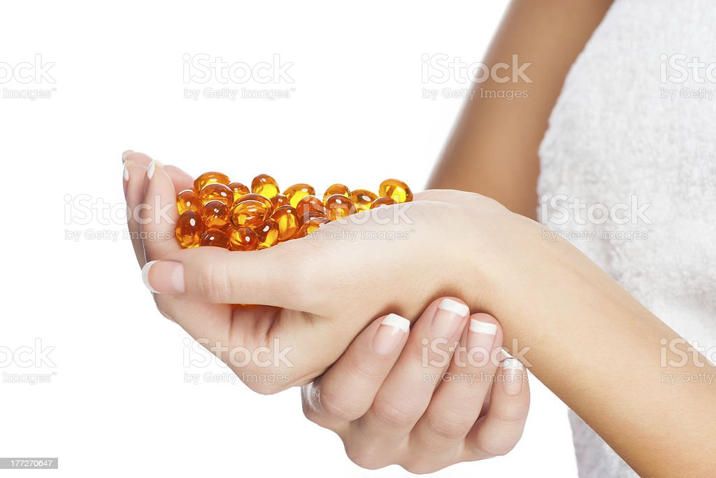 Woman hands with pillls royalty-free stock photo