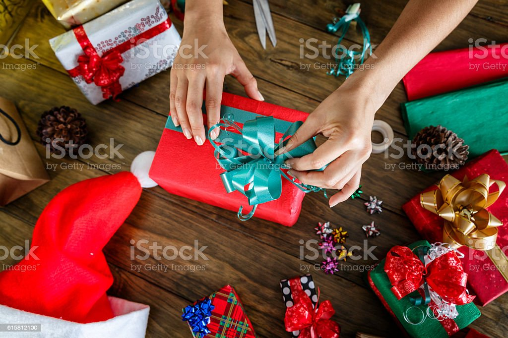 Woman hands wrapping Christmas Gifts stock photo