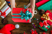Woman hands wrapping Christmas Gifts