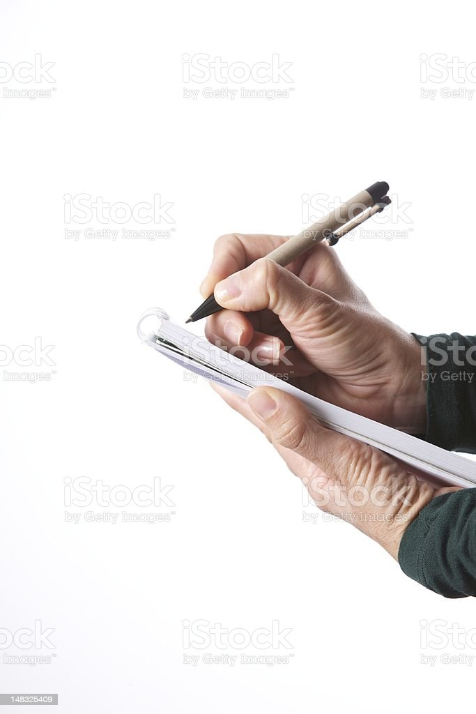 woman hands writing with pen on paper block isolated on white stock photo