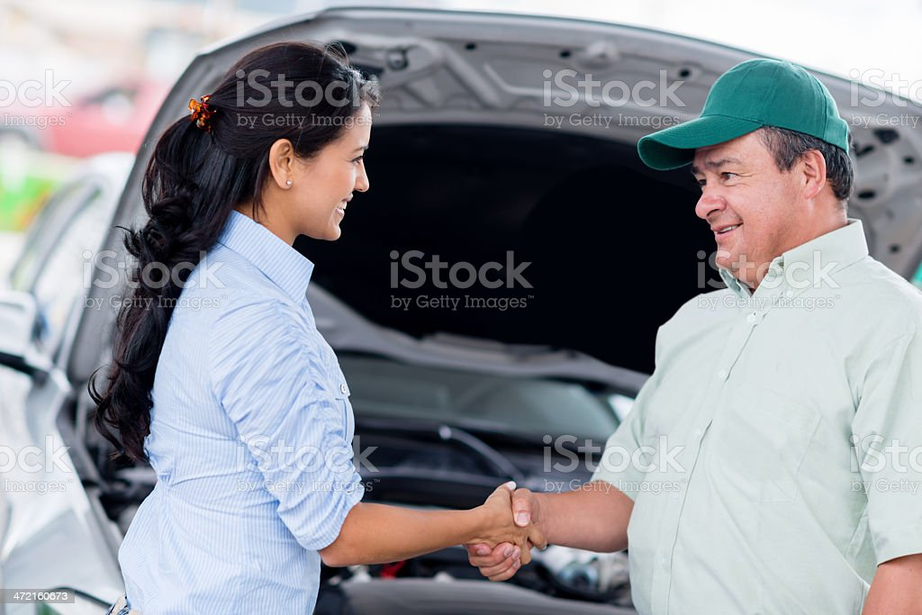 Woman handshaking with a mechanic royalty-free stock photo