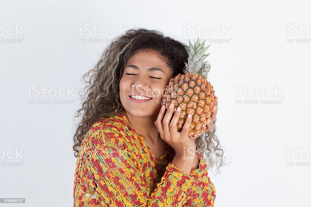 Woman hanging a pinaple stock photo