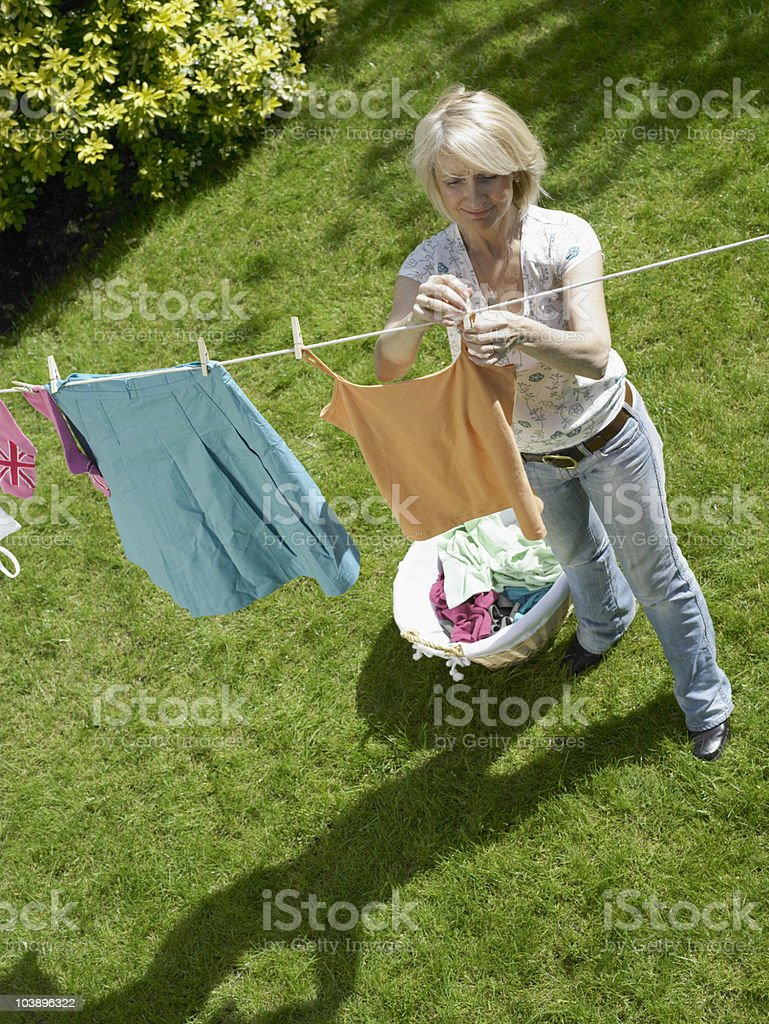 Woman hanging clothes on the line royalty-free stock photo