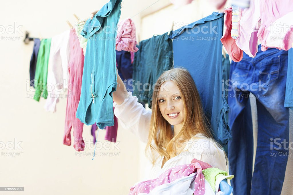 woman hangs clothes to dry royalty-free stock photo