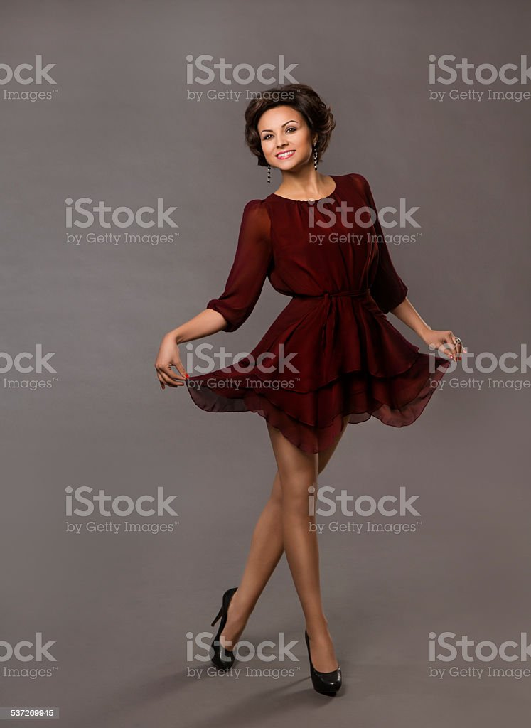 Woman Happy Dancing, Smiling Glad Girl Portrait, Fashion Red Dress stock photo