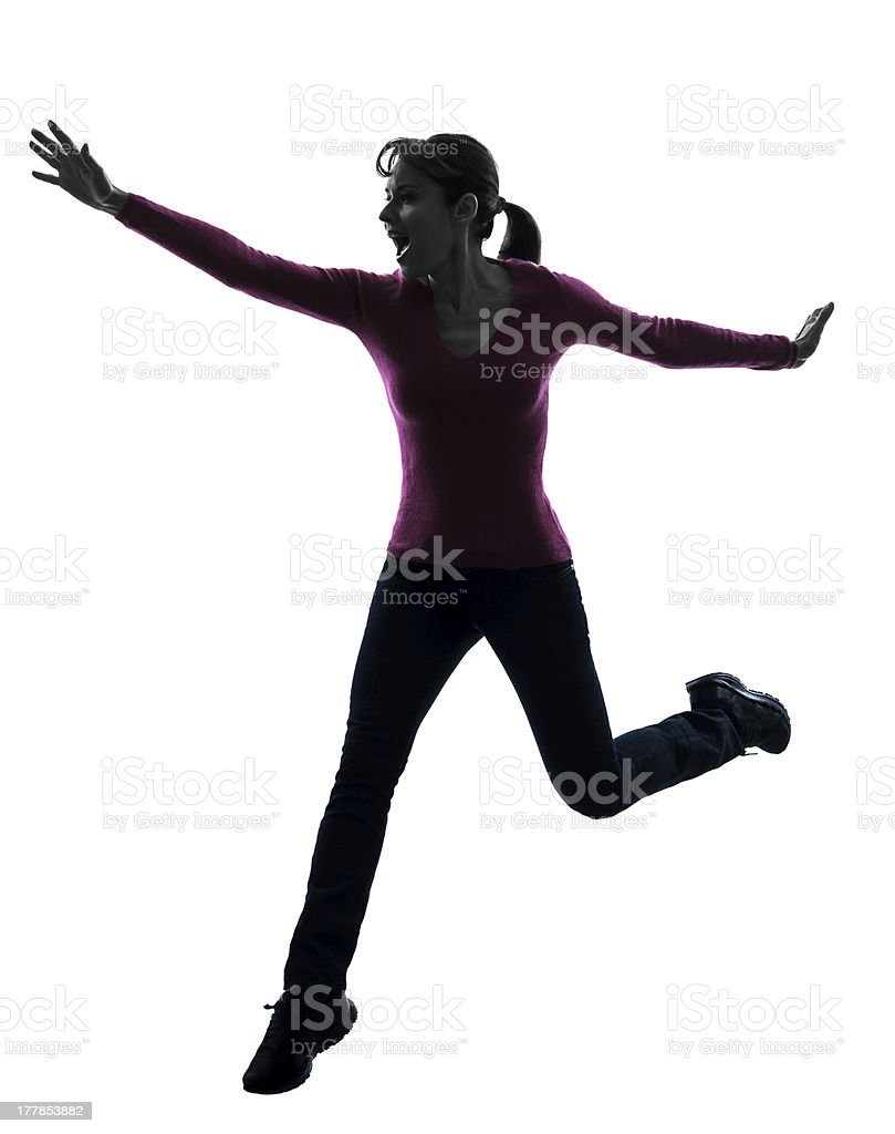 woman happy running jumping silhouette stock photo