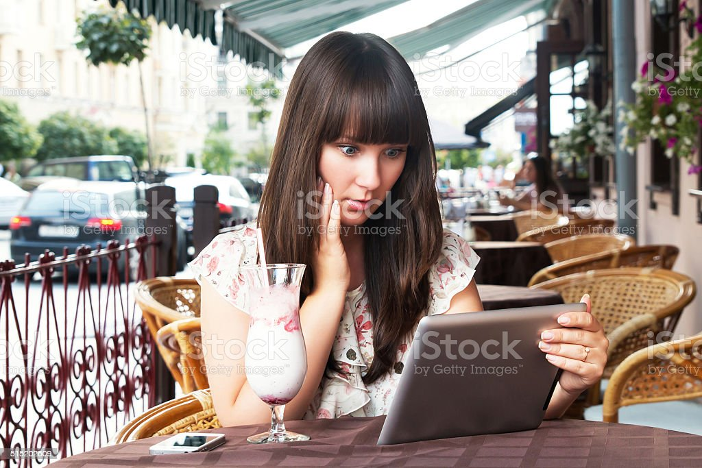 Woman has a rest in cafe stock photo