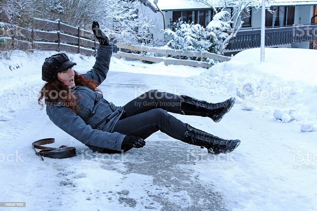A woman has fallen on an icy street stock photo
