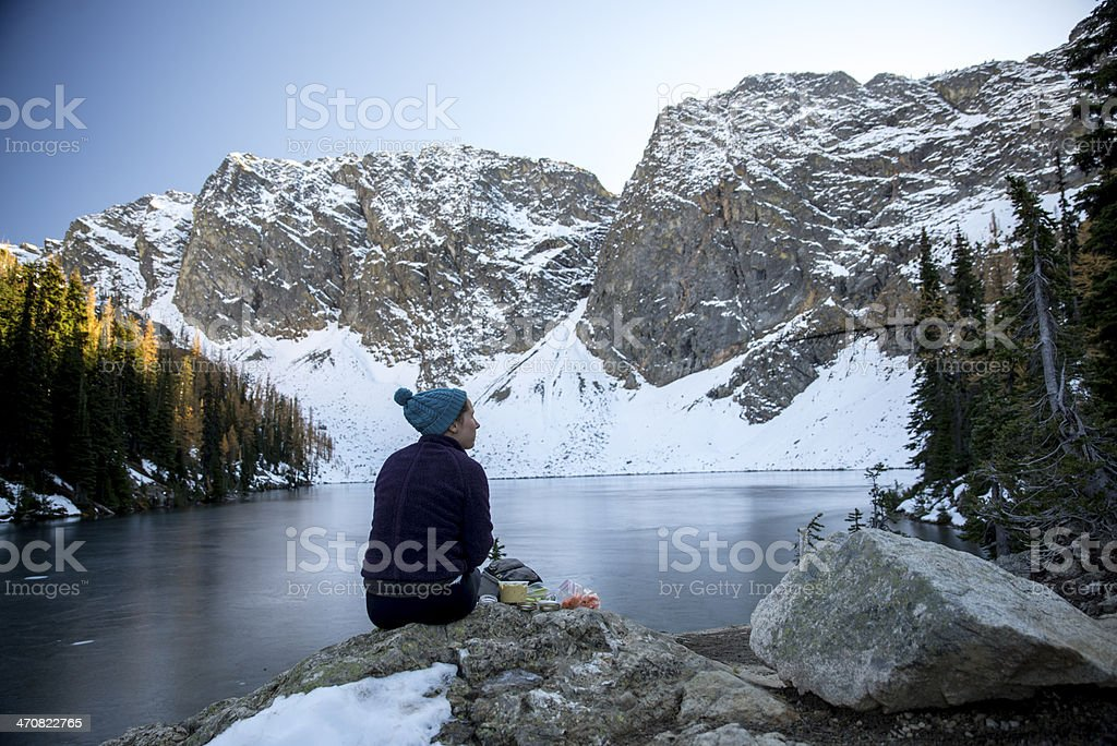 Woman Has Picnic by a Lake stock photo