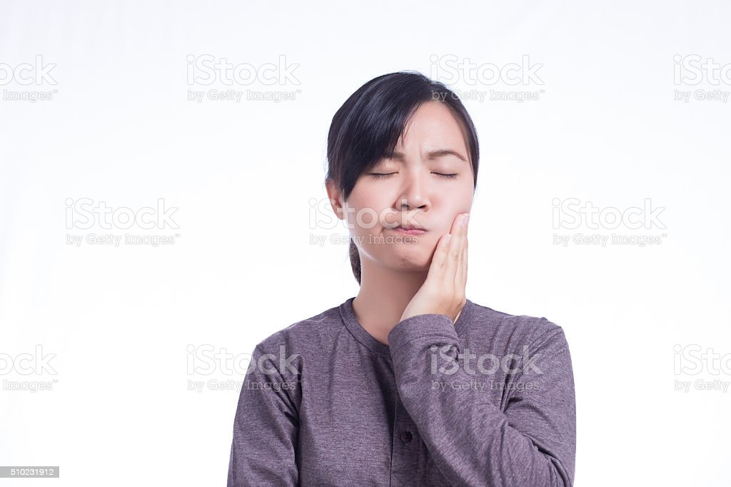 Woman Has Tooth Ache on Isolated White Background stock photo