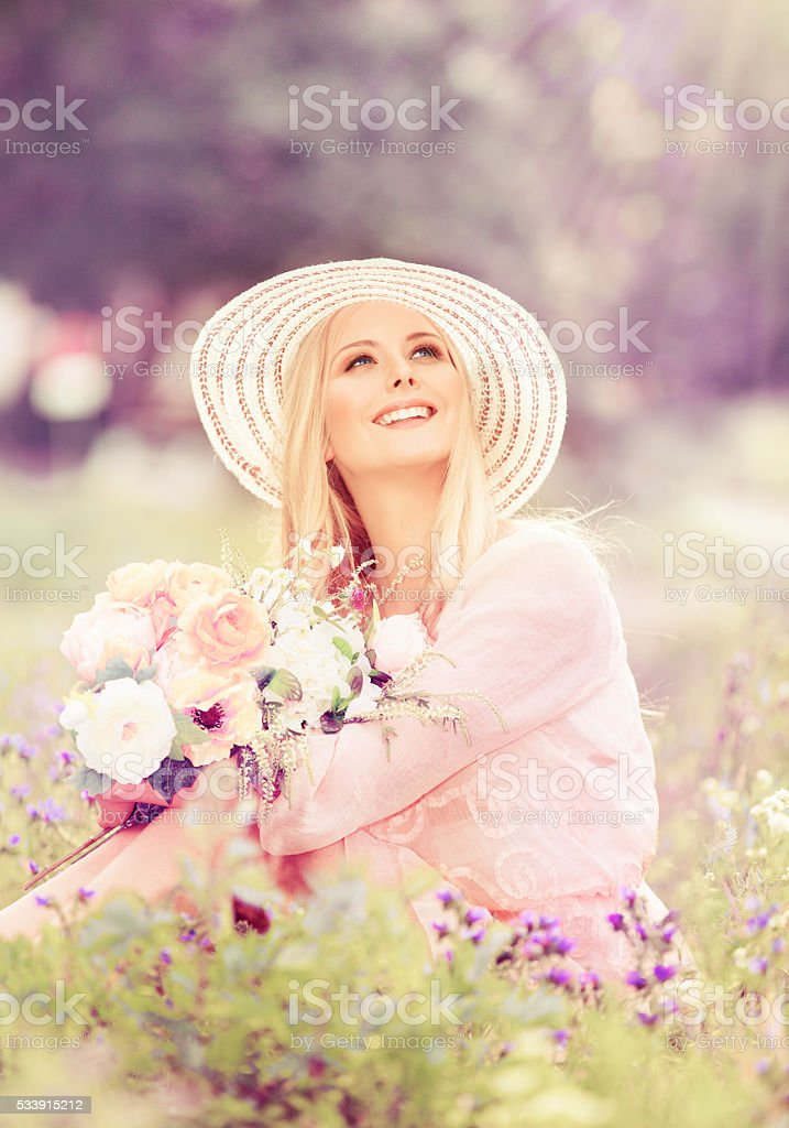 Woman Hat Flowers Bouquet, Fashion Model looking up, Summer Park stock photo