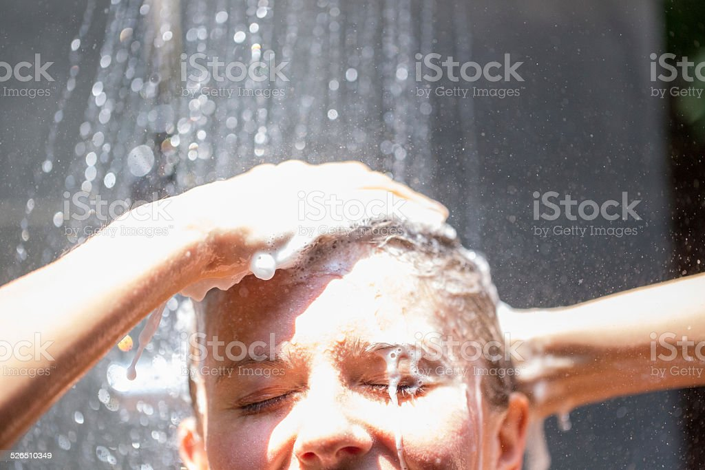 Woman have an outdoor shower stock photo