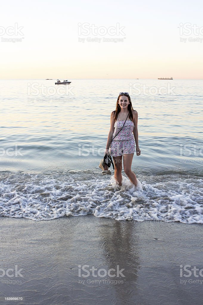Woman havin fun in the water at beach stock photo