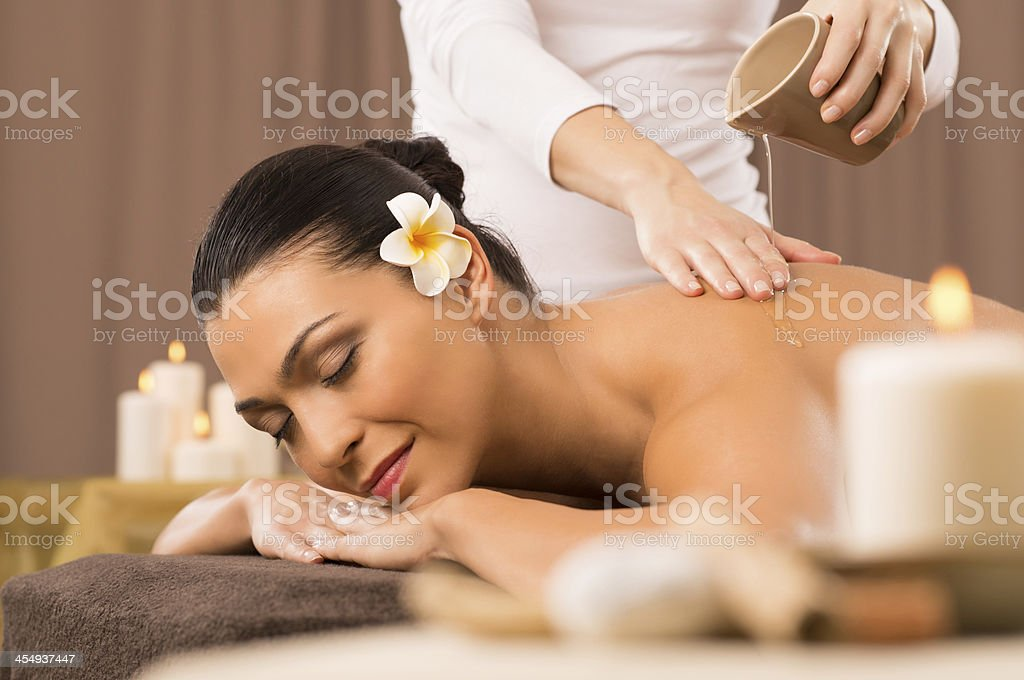 Woman Having A Back Oil Massage stock photo