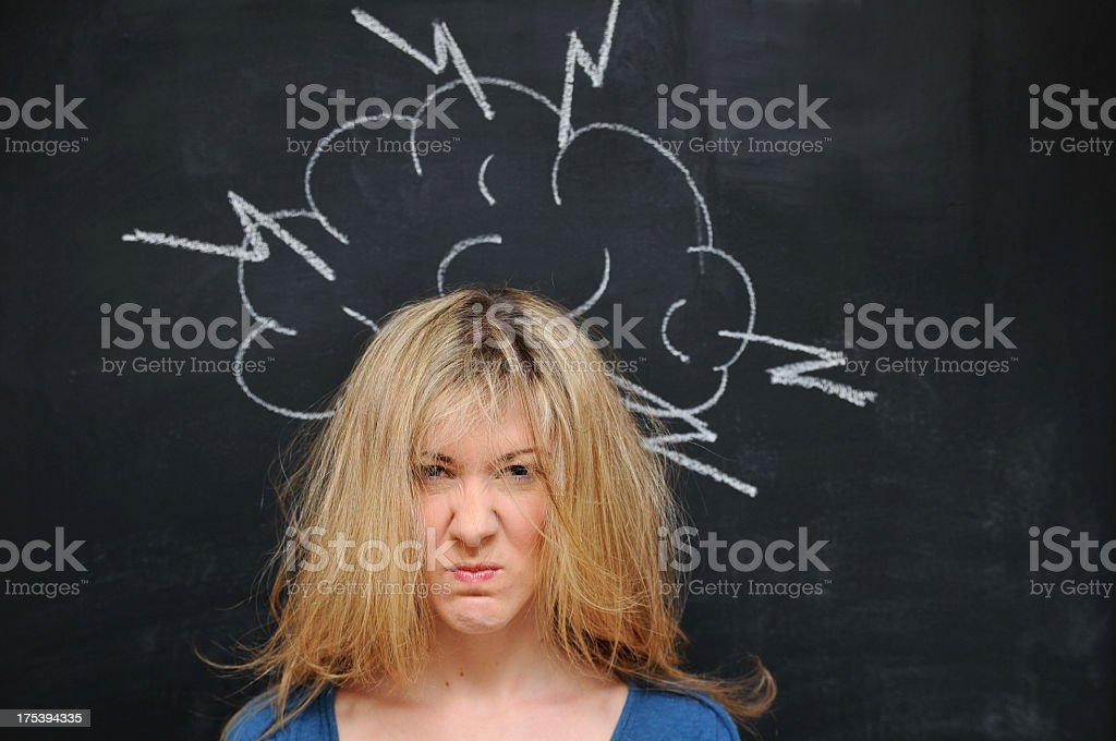 Woman having a bad day with storm drawing on a chalkboard stock photo