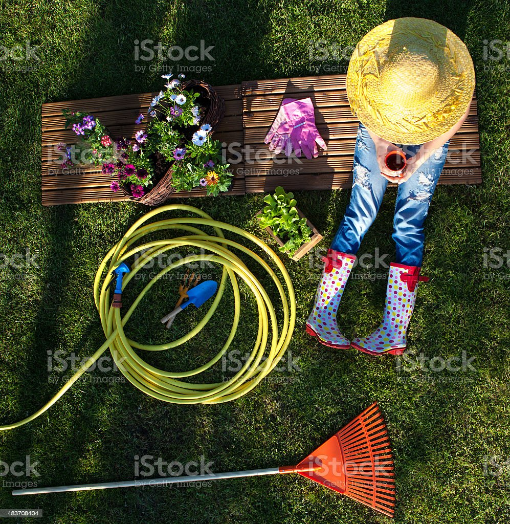 Woman having a break while working in the garden stock photo