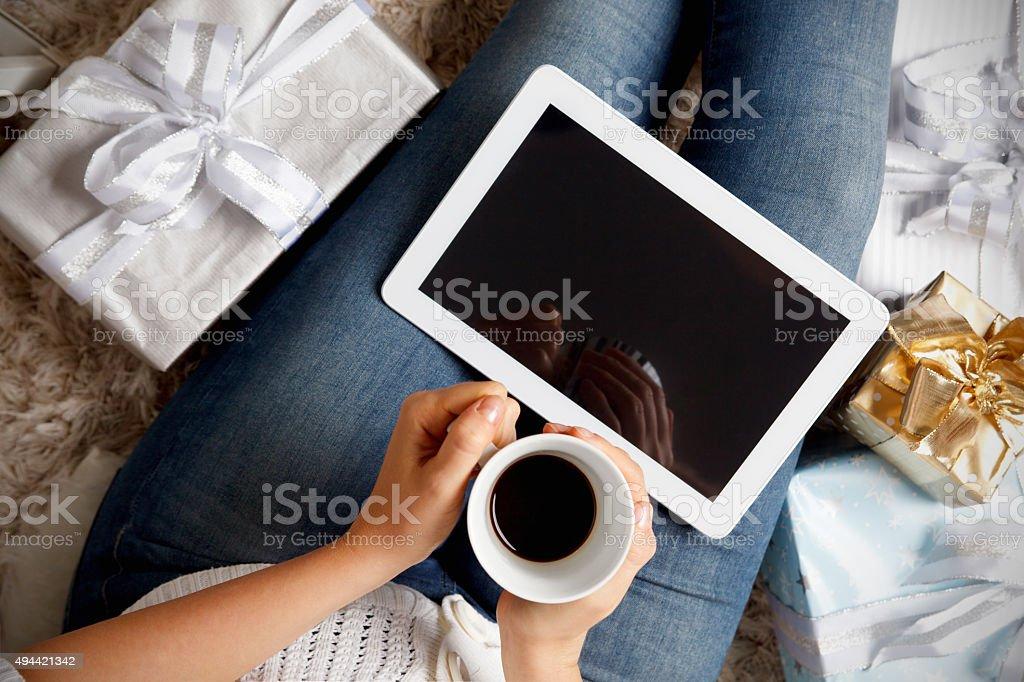 Woman having a coffee at Christmas stock photo