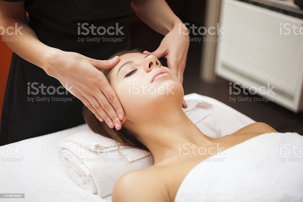 Woman having a facial massage stock photo